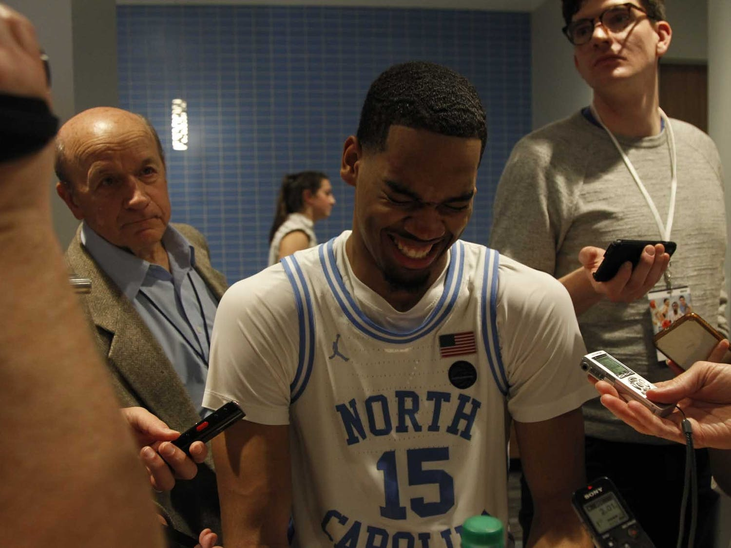 "Junior forward Garrison Brooks (15) laughs while speaking with the press after the game against N.C. State in the Smith Center on Tuesday, Feb. 25, 2020. UNC beat N.C. State 85-79. When asked how he felt, Brooks responded, ""100 (percent). I'm good. I'm good I'm good."""