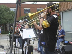 Musicians perform in cloudy conditions at the 2016 Carrboro Music Festival.