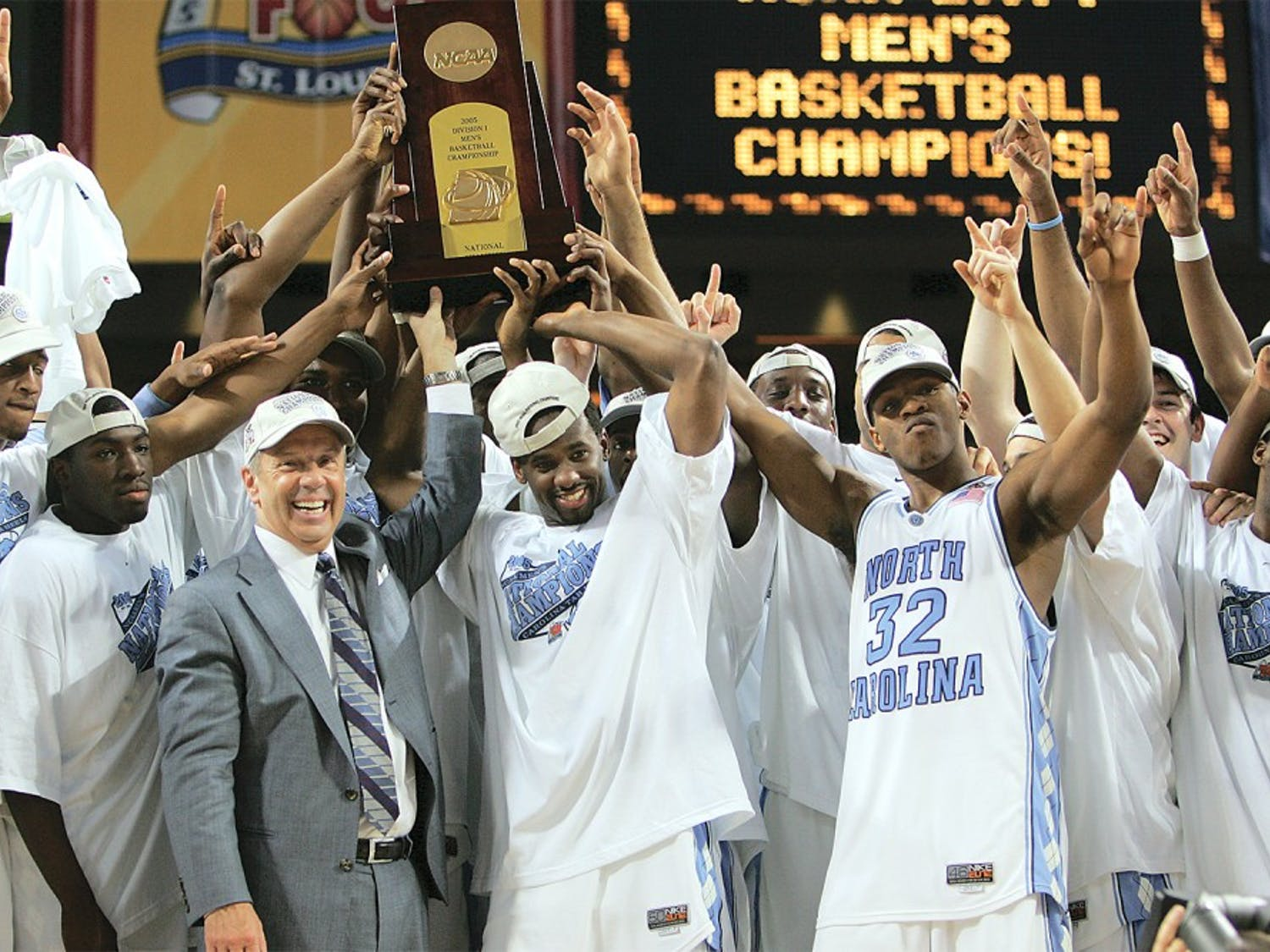DTH Archive. The 2005 National Championship team receives the title trophy following their 75-70 victory over Illinois, at the Edward Jones Dome in St. Louis, Missouri on April 4, 2005.