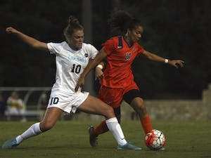Joanna Boyles (10) attempts a tackle against a Syracuse player.