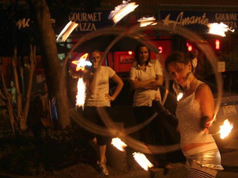 Professional hoop dancer Julia Hartsell spins two flaming hoops outside The ArtsCenter. DTH/Becca Brenner