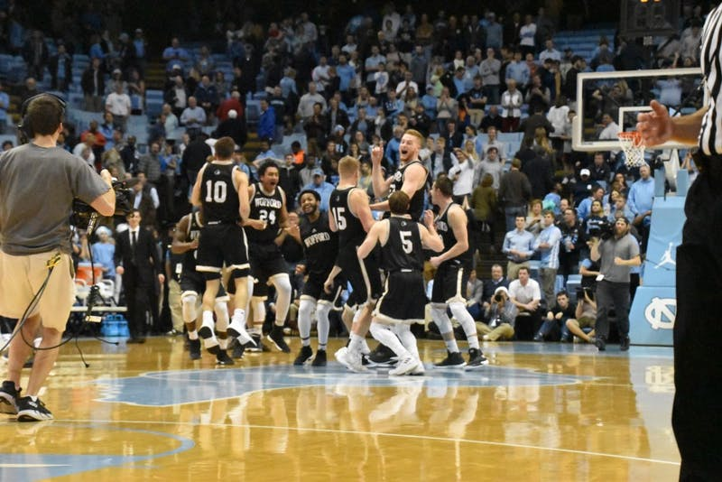 The Wofford men's basketball team celebrates after upsetting then-No. 5 North Carolina, 79-75, on Dec. 21 in the Smith Center.