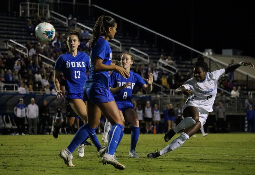 <p>Sophomore midfielder Brianna Pinto (8) attempts a shot in the game against Duke in Koskinen Stadium on Thursday, Oct.10, 2019.&nbsp;</p>
