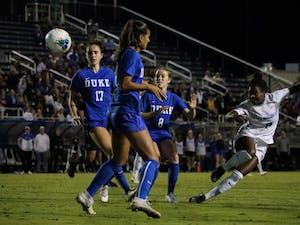 Sophomore midfielder Brianna Pinto (8) attempts a shot in the game against Duke in Koskinen Stadium on Thursday, Oct.10, 2019.