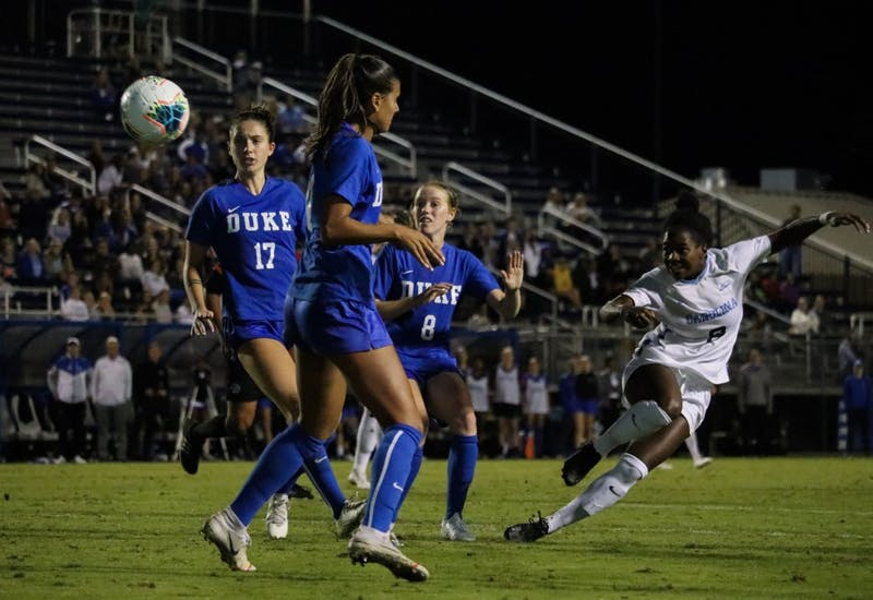 Sophomore midfielder Brianna Pinto (8) attempts a shot in the game against Duke in Koskinen Stadium on Thursday, Oct.10, 2019.