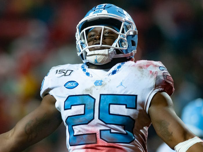 UNC's sophomore running back Javonte Williams hypes up the crowd after his touchdown during a game at Carter-Finley Stadium on Saturday, November 30, 2019.