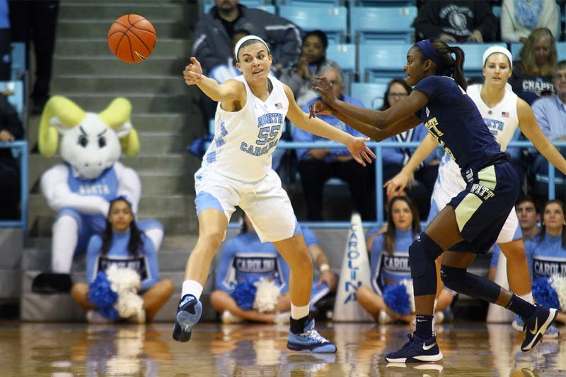 Forward Paige Neuenfeldt (55) deflects the ball in her first game as a Tar Heel in UNC Women's basketball's blowout loss to Pittsburgh on Thursday.