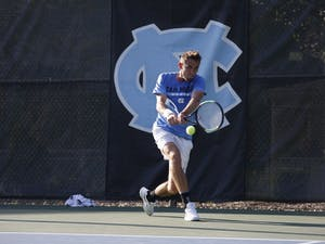 UNC men's tennis sophomore Benjamin Sigouin prepares to return the ball during a singles match against NC State on Wednesday April 3, 2019. UNC beat NC State 4-0.
