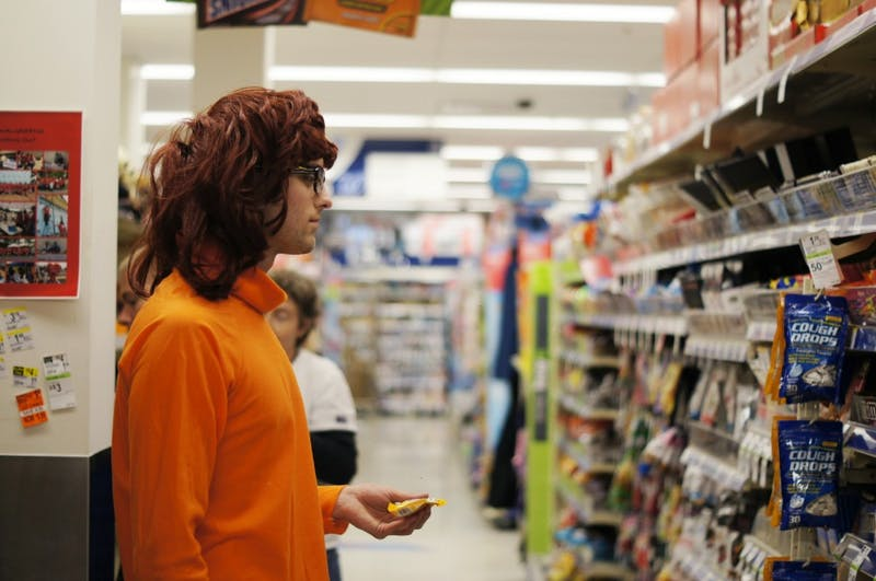 First-year UNC student Adam Oppenheimer dressed up as Velma from Scooby Doo debates what kind of candy he should buy.
