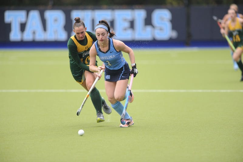 UNC forward Erin Matson (1) competes for the ball against William and Mary midfielder Ashleigh Nottingham (10) during the first round of the NCAA Tournament at Karen Shelton Stadium on Friday. UNC won 4-0.