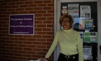 Kathy Atwater, the community advocacy coordinator for The Marian Cheek Jackson Center poses in front of the center on Thursday, April 11, 2019. Atwater has lived all her life in Chapel Hill, N.C. and a few years after retirement she decided to get involved with the Jackson Center. She said that her new work has brought her closer to her community. The center is located at 512 West Rosemary St.