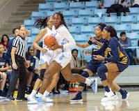 Center Janelle Bailey (UNC 44) escapes UNCG's defense during the UNC women's basketball home game vs. UNCG in Carmichael Arena on Friday, Dec. 14 2018.