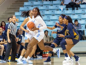 Center Janelle Bailey (UNC 44) escapes UNCG's defense during the UNC women's basketball home game vs. UNCG in Carmichael Arena on Friday, Dec. 14 2018.