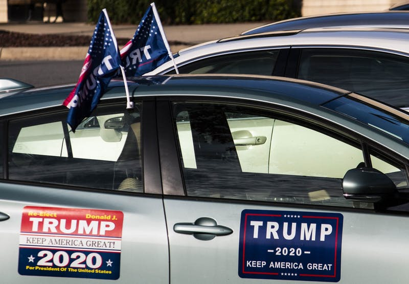 A car decked out in Trump prohpaganda sits at the University Mall shopping center early polling site on Thursday, Oct. 22, 2020.