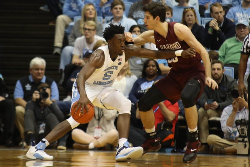 Harvard forward Danilo Djuricic (30) guards UNC forward Nassir Little (5)  in the Smith Center Wednesday, Jan. 2, 2019. UNC defeated Harvard 77-57.