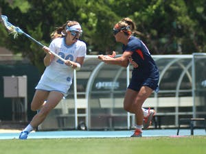 Molly Hendrickmaneuverstowards to goal during the Tar Heel's 10 to 9loss against UVA during the NCAAchampionship.