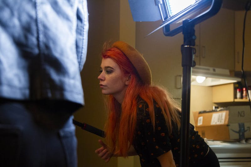 "Sophomore dramatic art and English major Grace Sword checks lighting while filming ""Black and Blue, ""a show she is developing with UNC Student Television, on campus on Wednesday, Feb, 12, 2020."