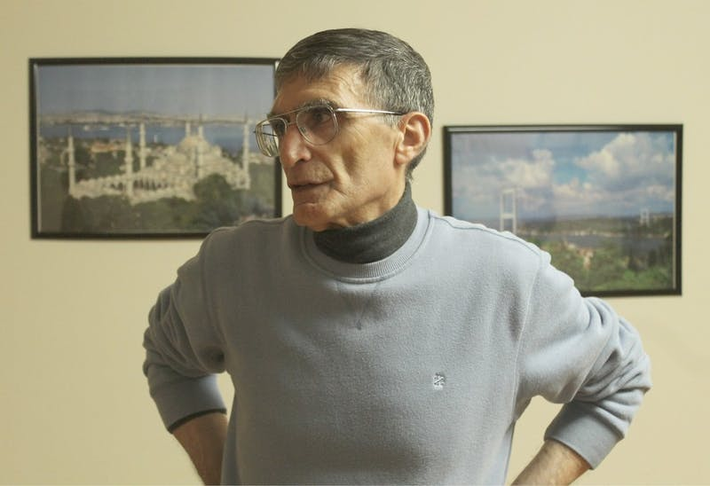 Aziz Sancar stands in the home he owns and runs for UNC students and scholars from Turkey to adjust to campus life.
