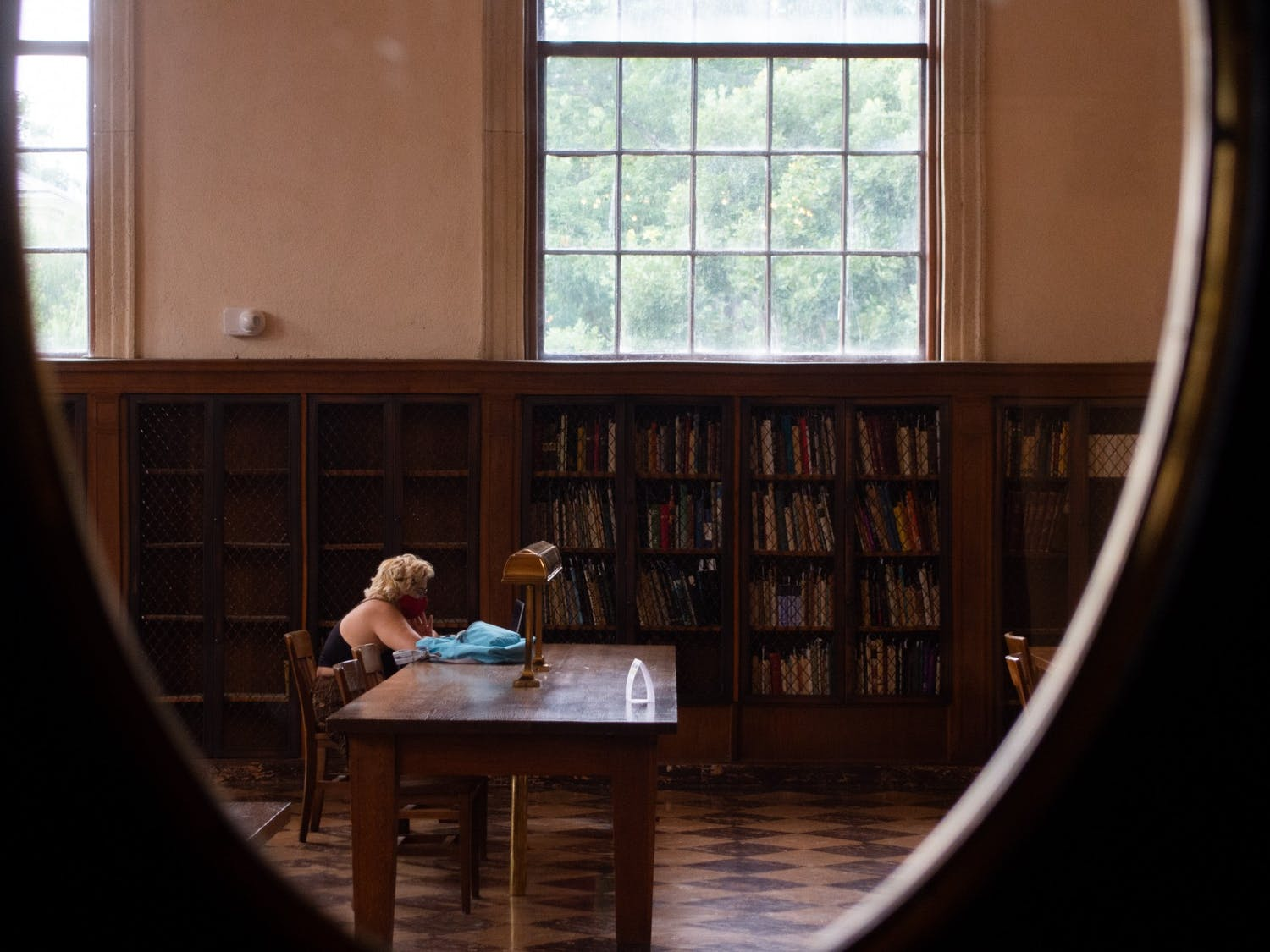Students return to UNC-Chapel Hill's Libraries before the start of the fall semester. The system has changed its building hours, added self-service checkout stations, and it has reduced overdue book fees.