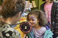 """Olivia, 6, got her face painted at the 300 East Main development open house Saturday. """"My favorite thing about Frozen is Olaf because he's funny,"""" Olivia said."""