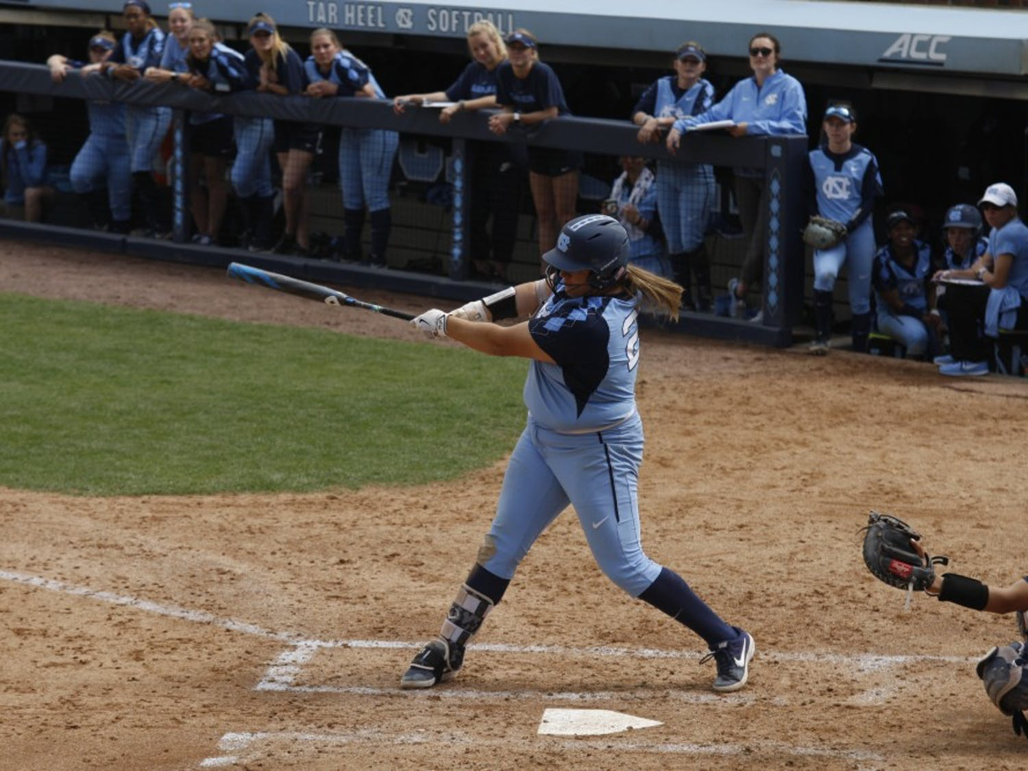Junior pitcher and first baseman Brittany Pickett (28) hits during UNC's double header against the University of Virginia. The Tar Heels won both games 8-0 at the G. Anderson Softball Stadium on Sunday, Apr. 7, 2019.