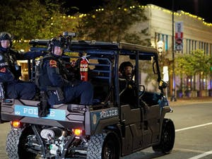 Police follow protesters in the streets of Raleigh on Nov. 3, 2020.