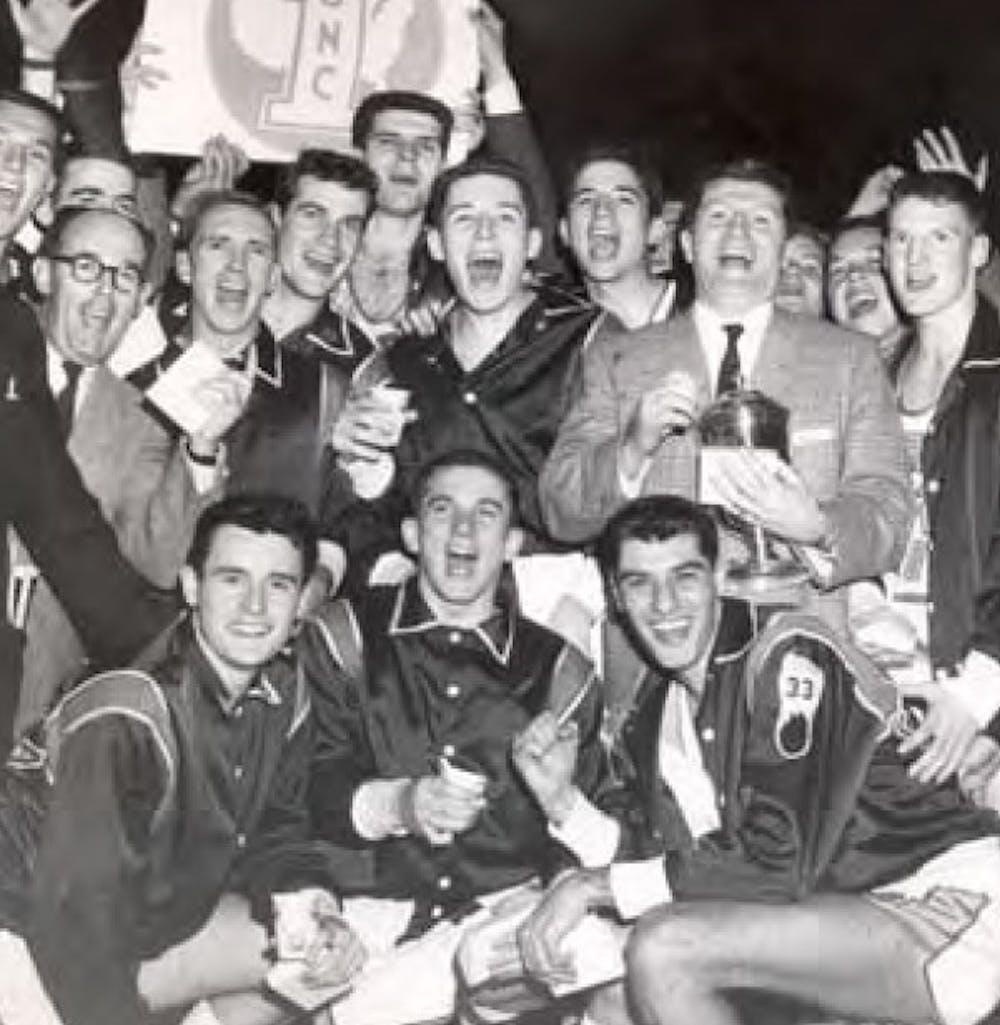 <p>The UNC 1957 men's basketball team celebrates its win. Photo courtesy of North Carolina Collection.</p>