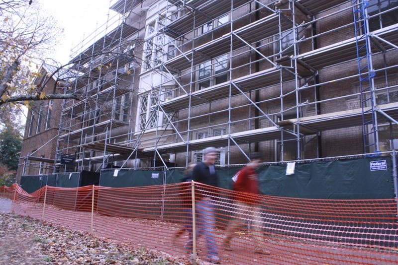 Students walk by construction on Battle, Vance and Pettigrew halls.  The construction project is one of many on UNC's campus. Most of the projects on campus are funded by the N.C. General Assembly, although some are privately funded. Campus officials are expecting a continued lack of funding since the midterm elections.