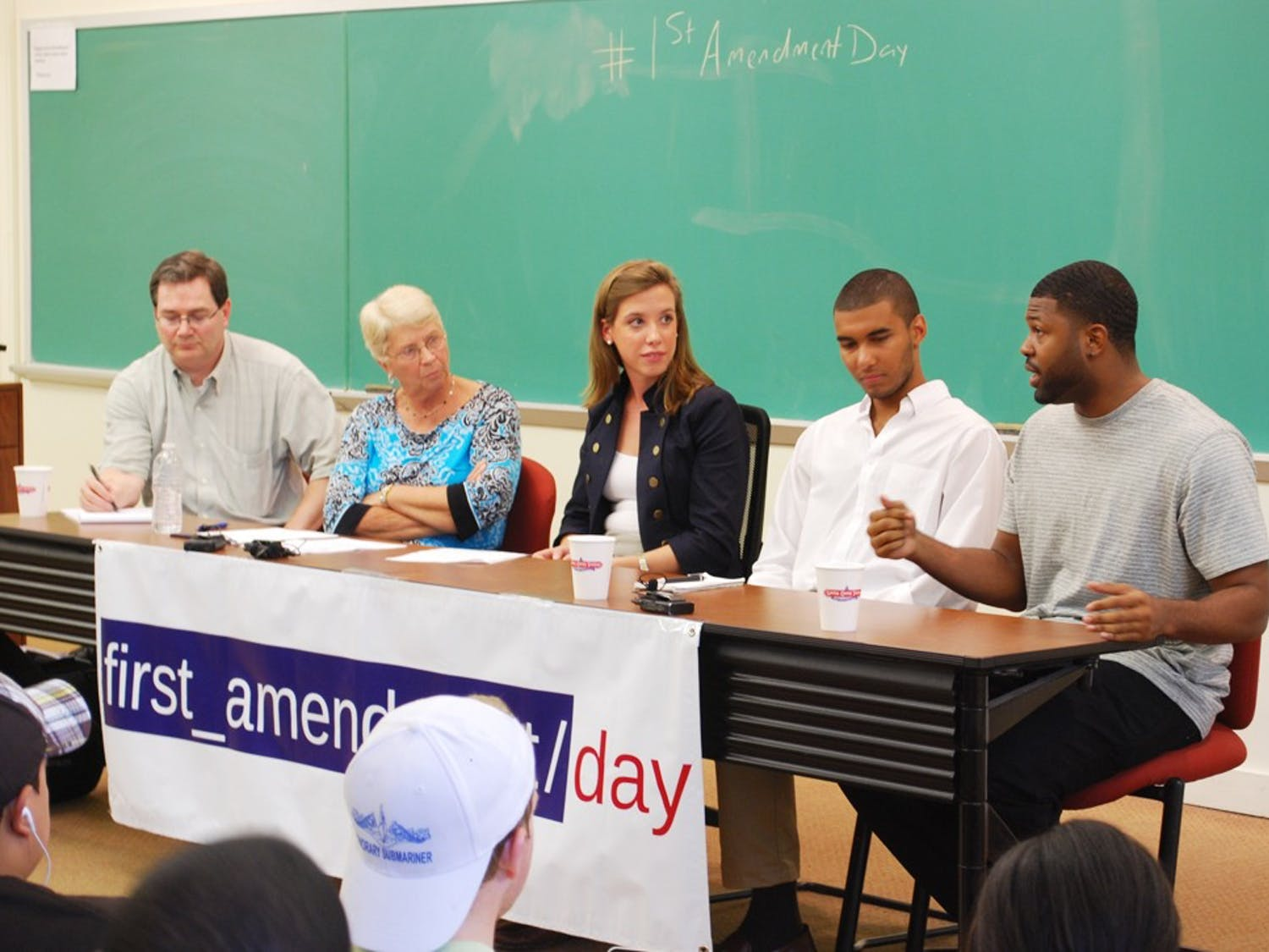 On Tuesday, September 27, UNC celebrated First Ammendment Day by hosting a panel in Carroll 103 to discuss UNC Football, Parking Tickets, FERPA, and Twitter. The Panel consisted of (from left to right in the photos): Dan Kane (News & Observer Investigative Reporter), Dr. Ruth Walden (Prof of Journalism), Jonathan Jones (DTH Senior Writer & Freelancer), and Deunta Williams (Former UNC Safety).The Moderator was Sarah Sessoms