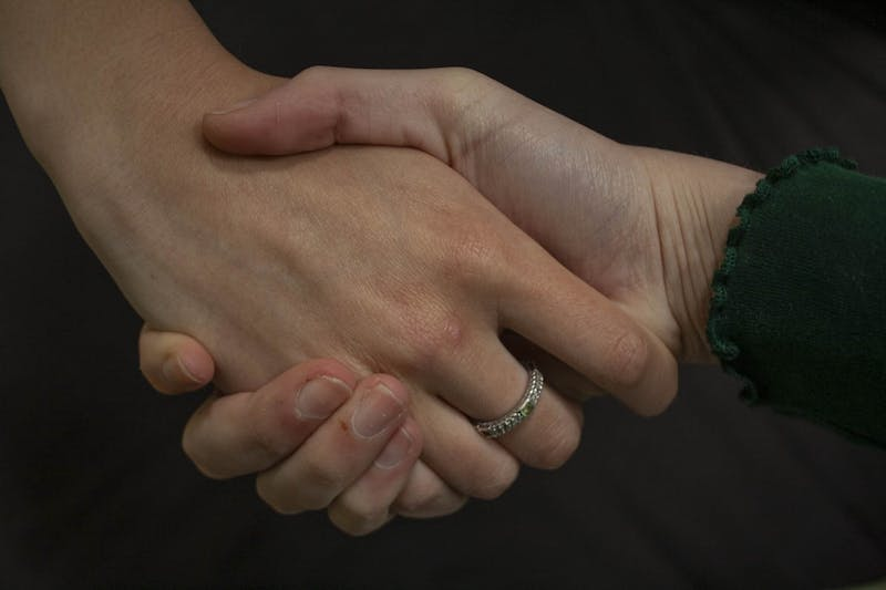 DTH Photo Illustration. Sociologists believe the handshake might disappear due to coronavirus.
