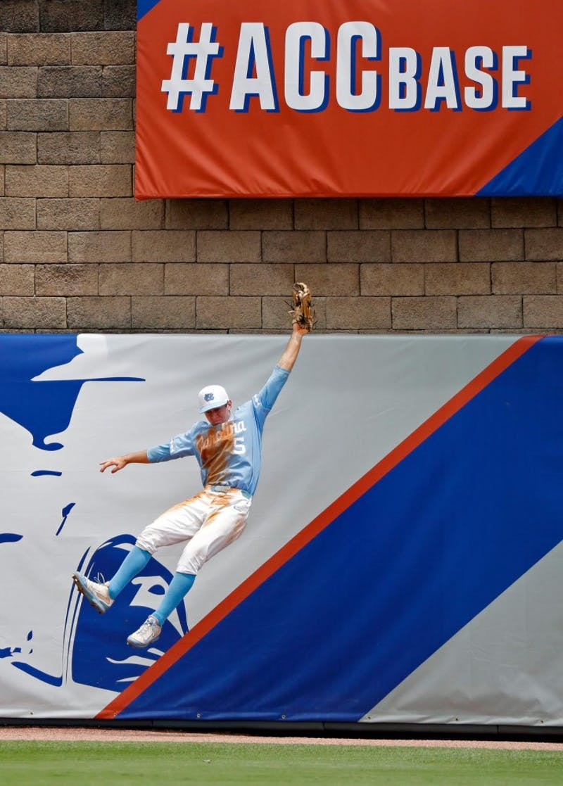 Michael Busch makes a catch against Florida State in the ACC baseball title game on May 28. Photo courtesy of Wade Payne of theACC.com