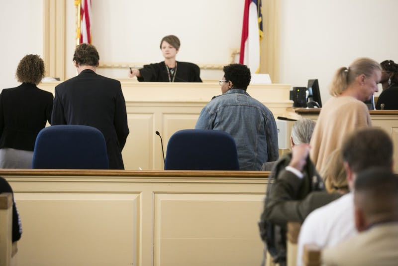 Maya Little and her lawyer stand before the judge as the hearing begins on Monday, Oct. 15, 2018, in Hillsboro N.C.