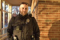 Sgt. Armstrong, a police officer in Carrboro, displays his WatchGuard body cam outside the Carrboro Police Station Wednesday, Nov. 28. The Carrboro Police Department recently received body cams for their officers to use while in the field.