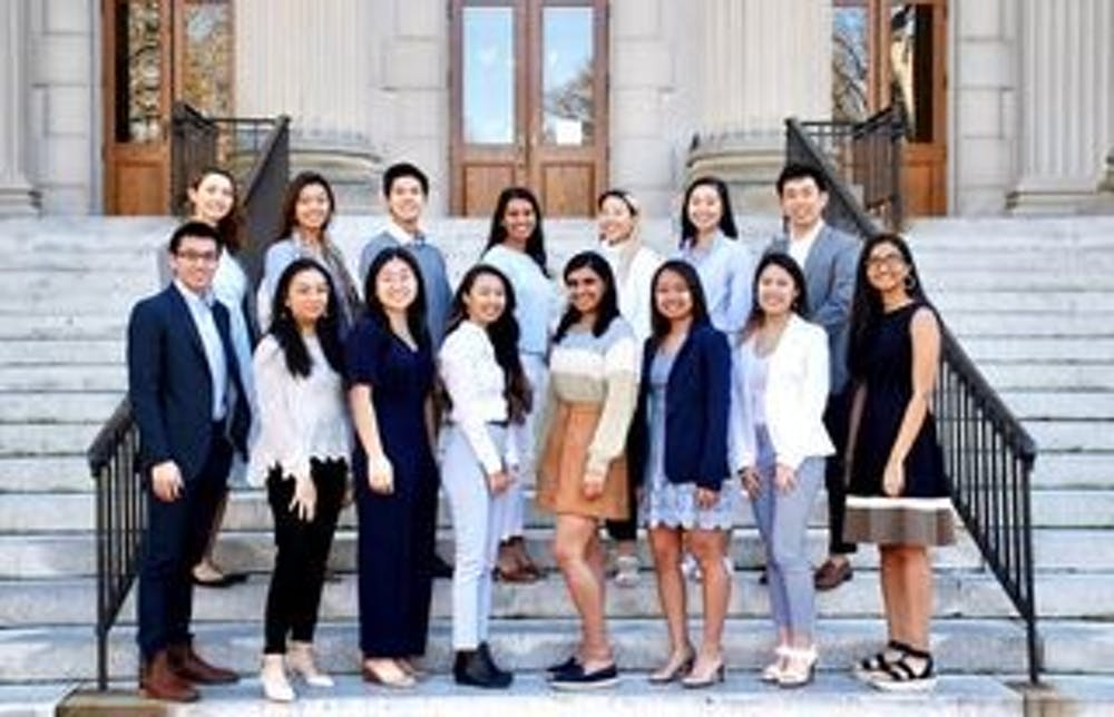 <p>The Asian American Center Campaigns team poses for a portrait on the steps of Wilson Library. Photo courtesy of Lynne Chen.</p>
