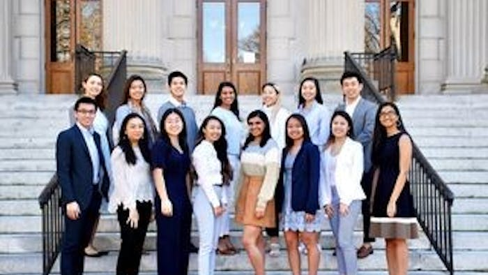 The Asian American Center Campaigns team poses for a portrait on the steps of Wilson Library. Photo courtesy of Lynne Chen.