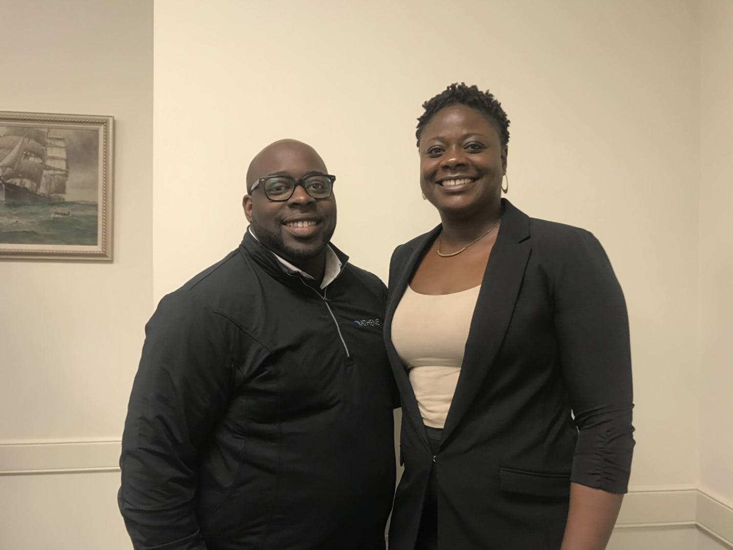 Brother and sister Robert Johnson (left) and Debra Johnson (right) pose together after the UNC School of Social Work's lecture 'Parenting Black Boys in America.'