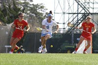 Marie McCool (4) goes for the ball between two Maryland defenders Saturday afternoon. The Tar Heels fell to 8-7.