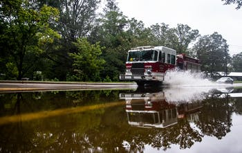A Carrboro fire truck drives through a flooded section of North Greensboro Street on September 17, 2018. Parts of Carrboro and Chapel Hill experienced flash flooding after feeling minimal effects from Hurricane Florence in early September.