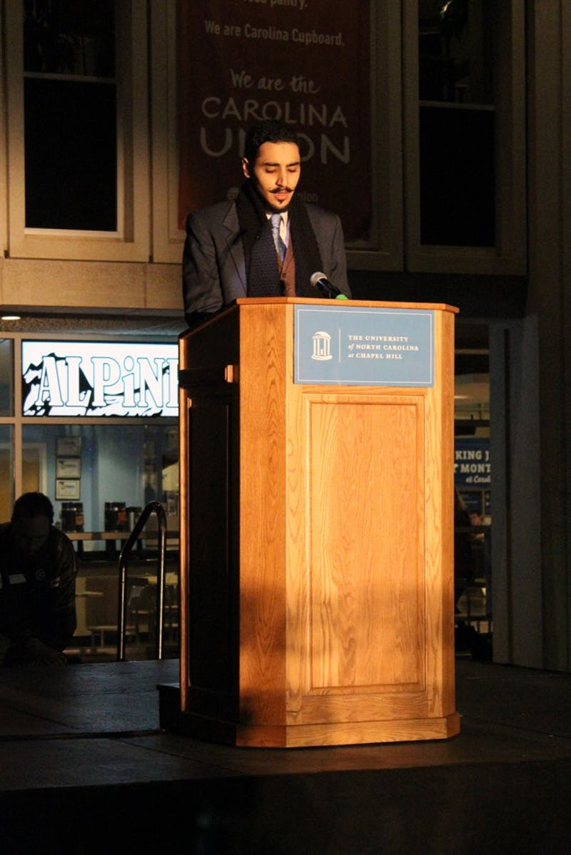 UNC junior Ahmad Mosabbeh gives a Quran recitation at the vigil for the commemoration of the lives of Deah Shaddy Barakat, Yusor Mohammad Abu-Salha and Razan Mohammad Abu-Salha.