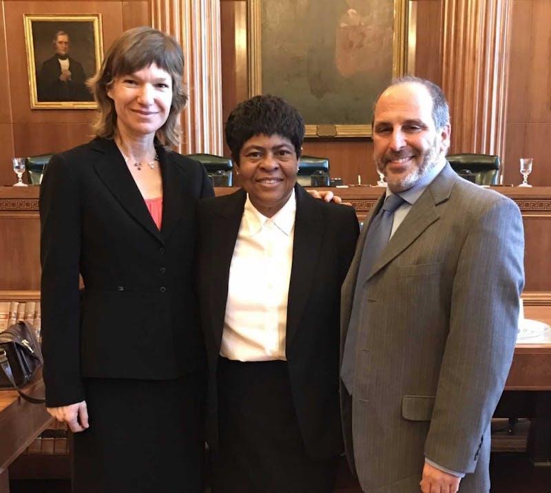 UNC law professor Elizabeth Haddix, left, and the center's managing attorney and UNC law professor Mark Dorosin, right, with Virginia Ingram. Photo courtesy of Haddix.
