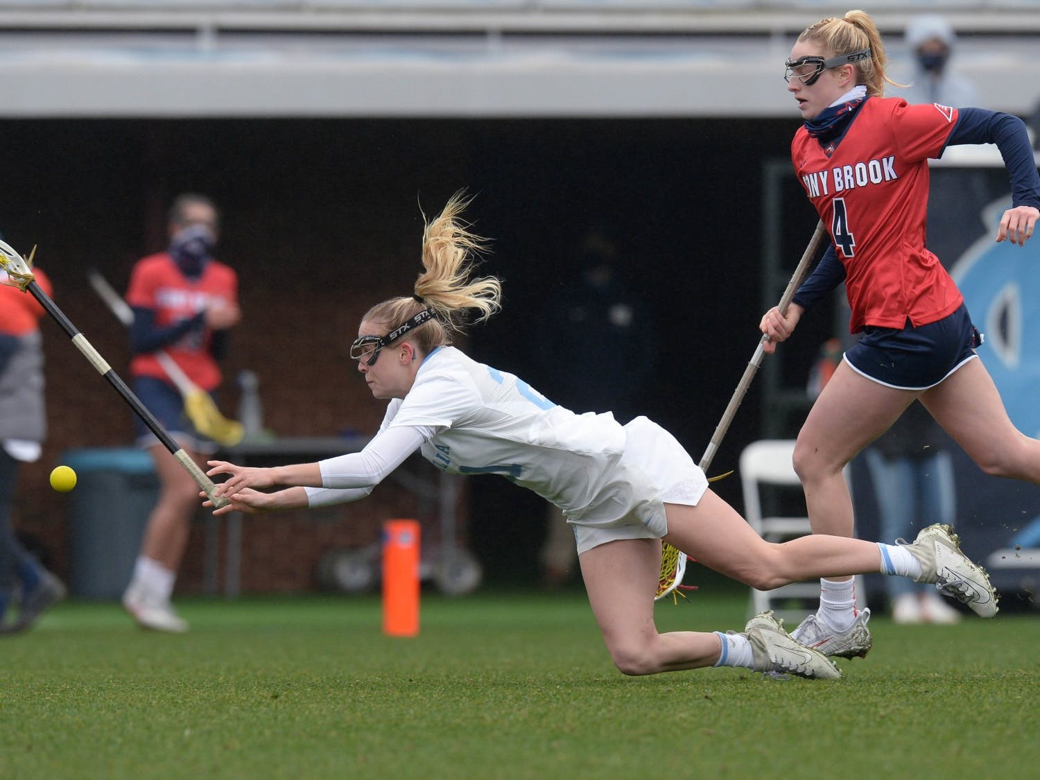 Redshirt sophomore midfielder Elizabeth Hillman lunges for the ball at the woman's lacrosse game against Stony Brook University at Dorrance Field on Sunday, Feb. 14, 2021. Photo courtesy of Jeffrey Camarati/UNC Athletics.