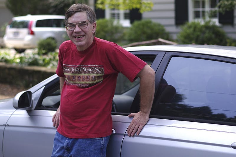 Libertarian candidate and pizza delivery man, Sean Haugh, stands in front of his car on August 16th, 2014.