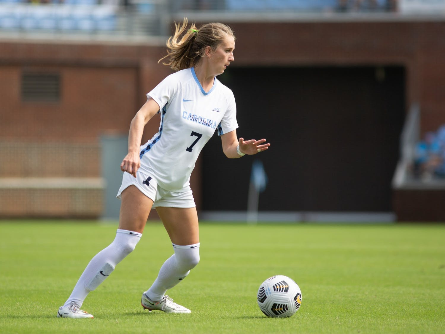 Junior defender Julia Dorsey (7) prepares to kick the ball in a game against the University of Virginia on Oct. 3. The Tar Heels tied with the Cavaliers 0-0.