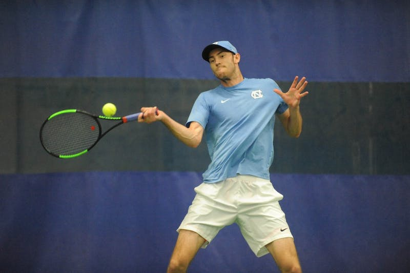Junior Josh Peck, exercise and sport science major, swings at the ball at the ACC tournament quarterfinals. UNC played against Louisville and won 4-0.