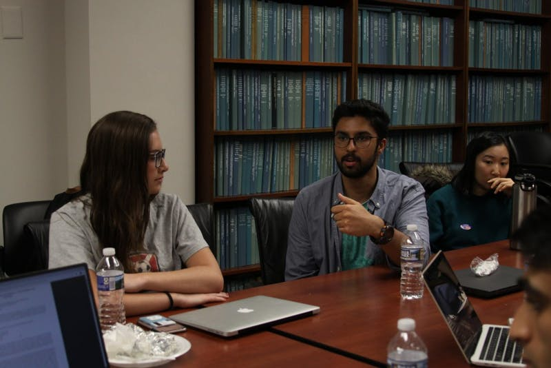 "Anamay Viswanathan, senior political science major, offers his thoughts during a group discussion at a meeting with the ""Tolerance in the Marketplace of Ideas"" research fellowship in Davie Hall on Tuesday, Nov. 6, 2018."