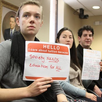 Student protestors freshman Ellen Currin (left), senior Caitlyn Williams, and senior Spencer Kuzmier and UNC-CH student body president Mary Cooper sit in on the UNC-system Board of Governors meeting on Thursday at 11a.m. discussing the possibility of tuition increase.  These protestors and many others held a march at 10:30 a.m. from the pit to the General Administration building.