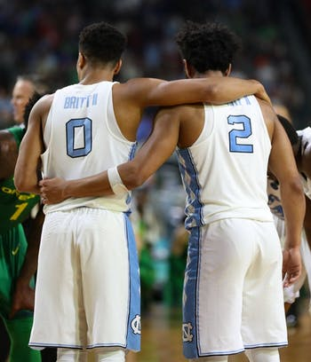 North Carolina guards Nate Britt (0) and Joel Berry (2) share a moment of embrace in between plays against Oregon in their Final Four matchup on Saturday in Phoenix.