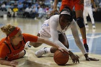 Sophomore center guard Janelle Bailey (44) fights for the ball during UNC's 70-53 win against Virginia at Carmichael Arena on Sunday, Feb. 17, 2019
