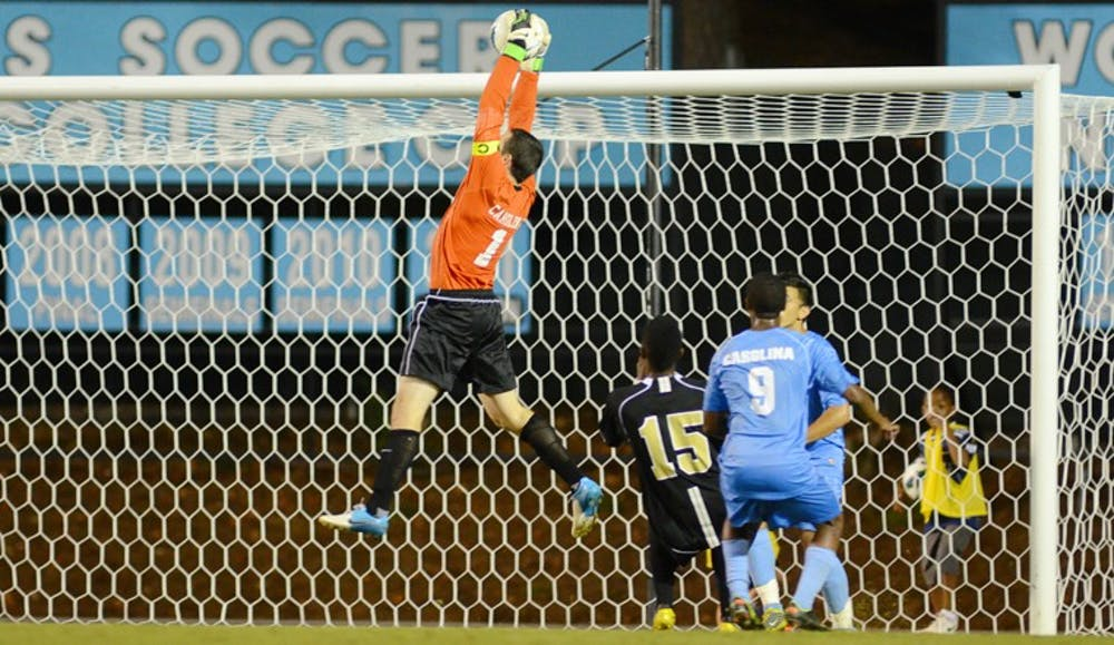 UNC Senior Scott Goodwin (1) makes a save against Wake Forest in Carolina's 0-0 draw on September 14th, 2012 at Fetzer Field in Chapel Hill, North Carolina.