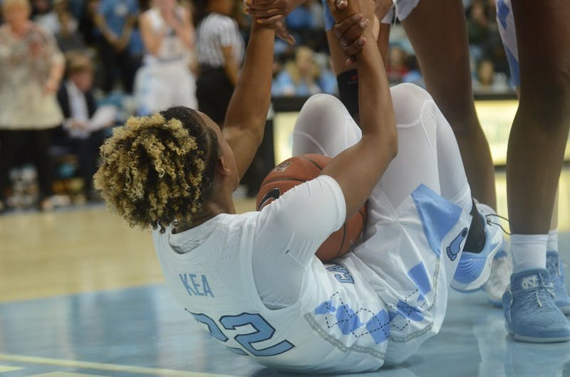 UNC women's basketball players help their teammate redshirt senior Paris Kea up after a Kent State player knocked her over during their game versus Kent State on Friday. UNC won the game 73-60.